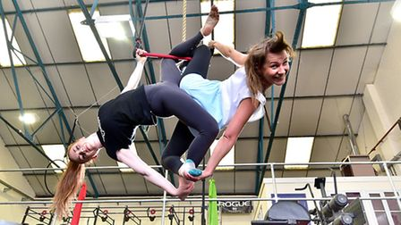 Spitfire Circus Arts coach Emily Quantrill, left, with class member Grace Williams. Picture: ANTONY
