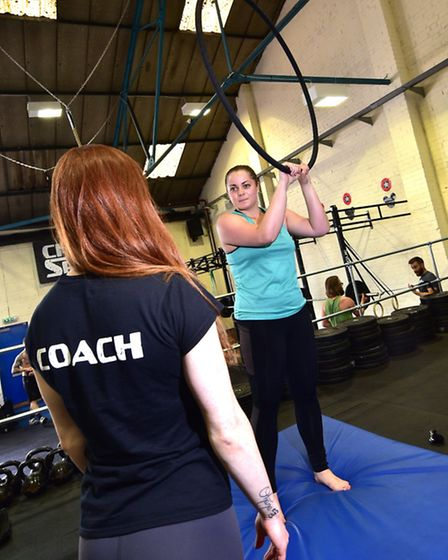 Reporter Jess Long having a circus fitness lesson at Spitfire Circus Arts. Pictured getting tips fro