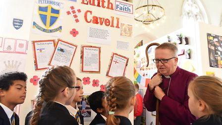 The Rt Revd Alan Winton Bishop of Thetford viewing a RE Celebration art exhibition being showcased