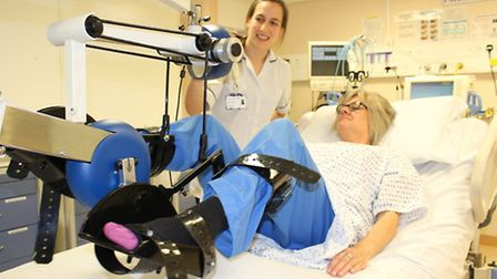 Physiotherapist Rosie Tulloch helps a patient with the bed bike at West Suffolk Hospital.