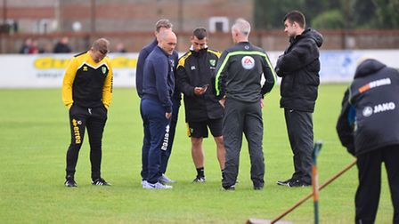 Norwich City boss Alex Neil on the pitch at Lowestoft Town talking to the officials prior to Tuesday