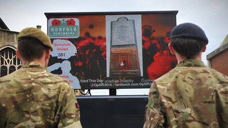 Serving soldiers watch as new photos arrive on the big screen at the Norfolk Remembers event at The