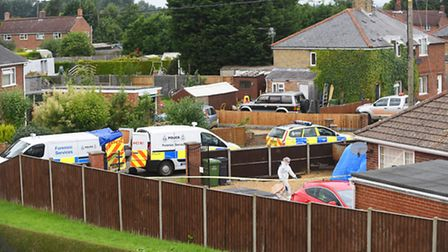 Forensic and Police officers at the scene of a firearms incident in Magdalen. Picture: Ian Burt