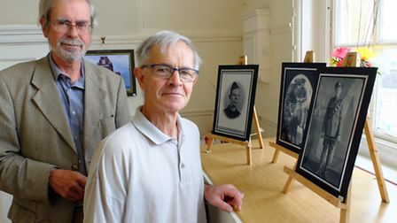 Robert Kybird, left, and David Osborne at the Thetford Remembers photo exhibition.