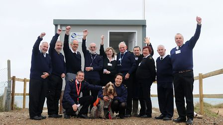 Clyde the dog with Happisburgh Coastwatch volunteers, back left to right, Roy Speed, Gareth Pritchar