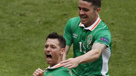 Republic of Ireland's Wes Hoolahan, right, celebrates with Robbie Brady after scoring the opening go