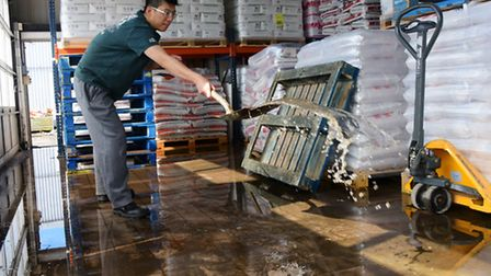 Staff at Oriental Delight, including warehouse manager Marty Ma, in Whiffler Road, Norwich clear up