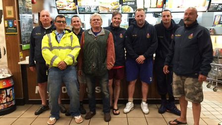 Man forth from left treats lifeboat crew to McDonalds following morning rescue