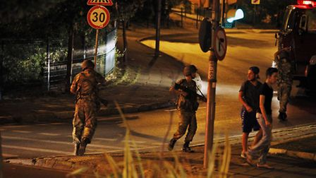 Turkish soldiers are seen on the Asian side of Istanbul, Friday, July 15, 2016. A group within Turke