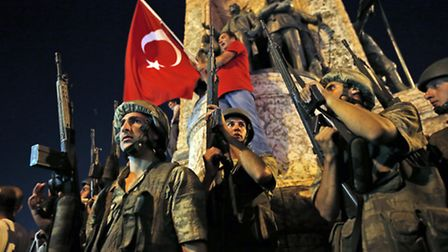 Turkish soldiers secure Istanbul's Taksim square, as supporters of Turkey's President Recep Tayyip E