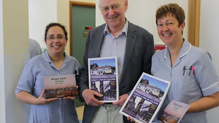 Bob Booth has donated 12 of his books to the QEH: Pictured are, L-R, Theresa Mota, Bob Booth and Lor