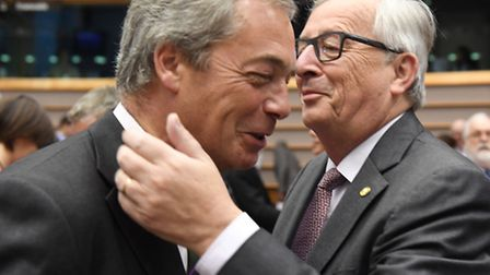 European Commission President Jean-Claude Juncker, right, greets UKIP leader Nigel Farage during a s
