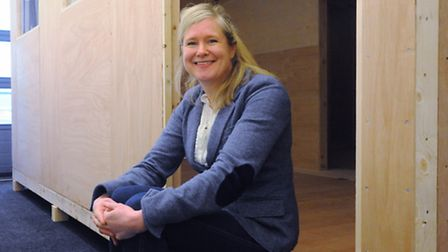 Extremis Technology CEO Julia Glenn with one of their disaster shelters, HuSh1, which have been depl