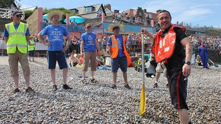 Lifeboat helmsman Steve Banks faces some ribbing from carnival committee members after being tipped