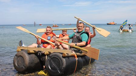 The Lobster pub team race to second place in their barrel raft. Picture: KAREN BETHELL
