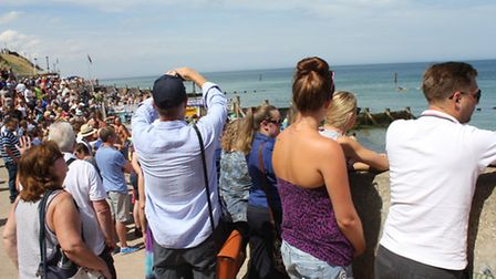 Crowds lining the prom to watch Sheringham carnival raft race. Picture: KAREN BETHELL