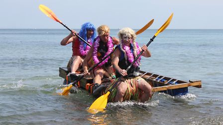 A Hawaiian-themed raft makes its way back to shore. Picture: KAREN BETHELL