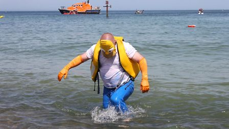 Homer Simpson makes his way to the beach at the end of Sheringham carnival raft race. Picture: KAREN
