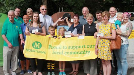 Morrisons Cromer community champion Simon Clipsom (back, right) with representatives from the ten lo