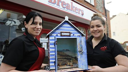 Ema Scott Rowlands and Claudia Martinez of Breakers Cafe in Cromer with their decorated beach hut. P