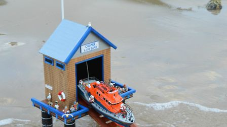 Sabre Tackle, Cromer's, decoratedi beach hut, which has been turned into a mini lifeboat station. Pi