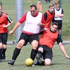 Football action as England (red) and West Germany (white) collide at the World Cup themed day at Wav