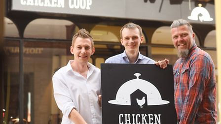 The Chicken Coup in Tower Street is open for business. Pictured are (from left) Graham Ridgwell, Sim