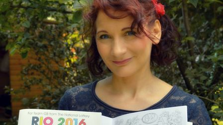 Kirsty O'Leary-Leesen with the colouring book which features her designs.