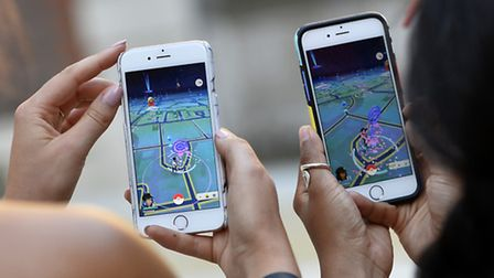 People on the hunt for Pokemon. Picture: Press Association.