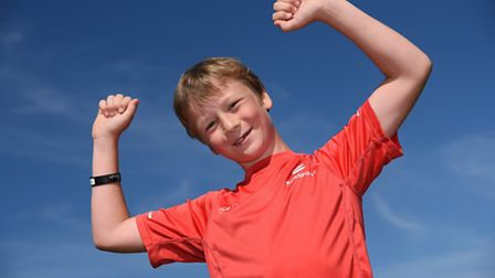 Eight-year-old Henry Kerrison celebrates his 100th Parkrun, at Eaton Park. Picture: DENISE BRADLEY