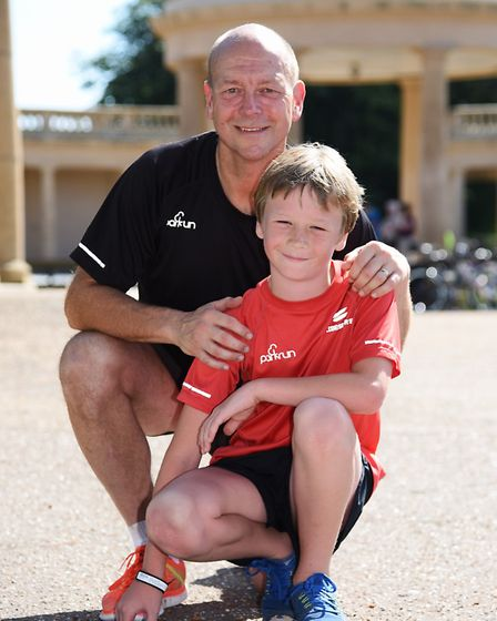 Eight-year-old Henry Kerrison who has just completed his his 100th Parkrun, with his dad John at Eat