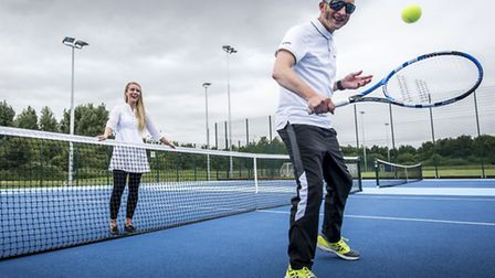 The new tennis court at Alive Lynnsport - Tennis development manager Jodie McGill watches Tony Deve