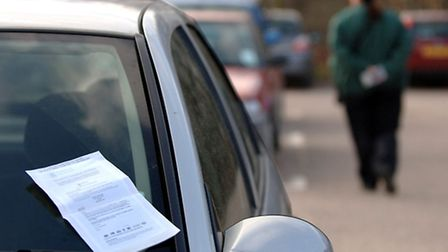 A penalty charge notice left on a city car. Photo: Denise Bradley.