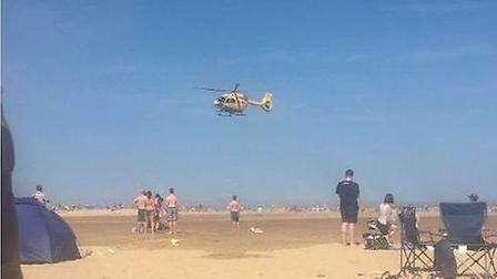 A man in his 50s is airlifted to hospital following a cardiac arrest.