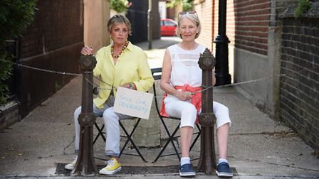 Residents Lesley Cunneen, left, and Marilyn Mann, hoping to save the ornamental bollards on an alley