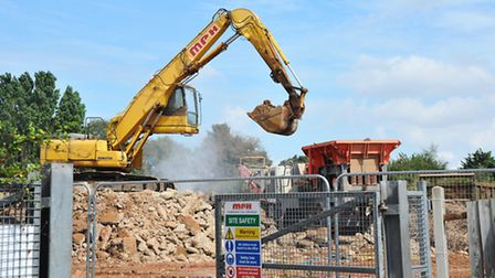 Demolition crews crushing rubble on the former CTD site on Eversley Road, Norwich, resulting in lots
