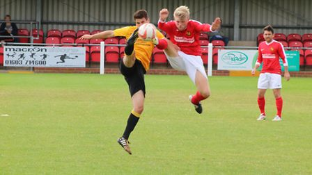 Jack Barber, left, in action for Fakenham Town on Saturday. Picture: TONY MILES