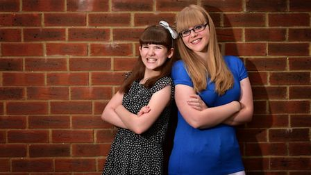 Laura Chapman with her older sister Jade who runs the Let Sign Shine campaign.Picture: ANTONY KELLY