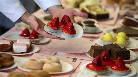 Cakes are examined during a baking competition. Photo: Andrew Milligan/PA Wire