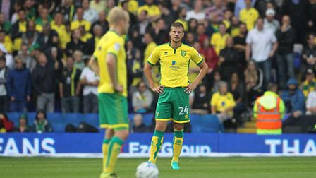 Norwich City duo Steven Naismith and Ryan Bennett cut dejected figures at Birmingham City. Picture b
