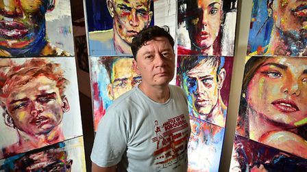 Asylum art exhibition at The Undercroft, Norwich. Artist and curator Gennadiy Ivanov with some of hi