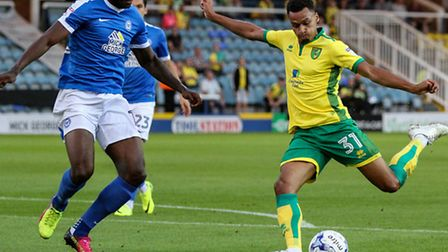 Josh Murphy of Norwich City U23 (right) unleashes a shot during the Checkatrade Trophy match at Lond