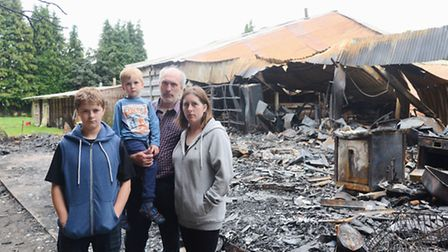 The family home of Alex and Faye Morse in Shipdham was destroyed by fire. Also pictured are their ch