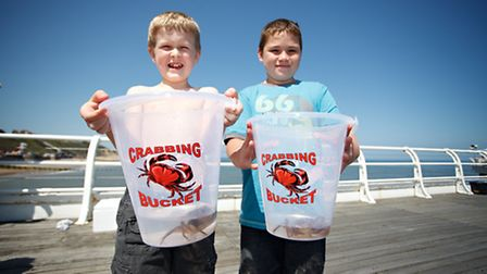 Two young competitors in last year's World Pier Crabbing Championships at Cromer. Picture: CRAB AND
