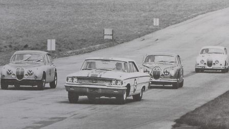 The crucial moment when Jack Sears swept past three Jaguar 3.8's in 1963.PHOTO: IAN BURTCOPY:Tom Wal