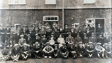 The first company photograph of WS Lusher Ltd staff in 1924 with owner WS Lusher centre holding the