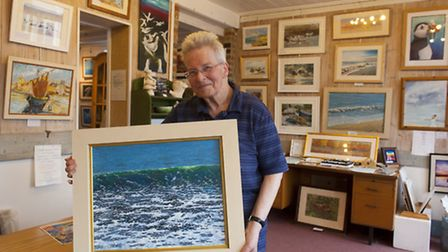 A Maritime art exhibition is now open at the Lowestoft Arts Centre. Carolyn Reeder with some of the