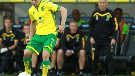 Steven Naismith is watched in the background by Norwich City manager Alex Neil. Picture by Sean Demp