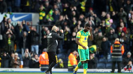 Norwich City manager Alex Neil celebrates victory with the travelling fans at the end of the Champio