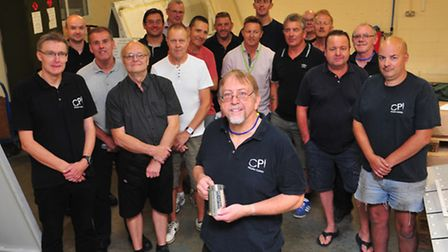 Roger Moore has been working at William Clowes printing works for 50 years, pictured with some of hi